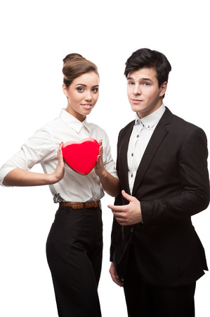 caucasian young business people holding red heart isolated on white photo