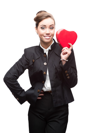 caucasian young happy smiling business woman holding red heart. isolated on white photo