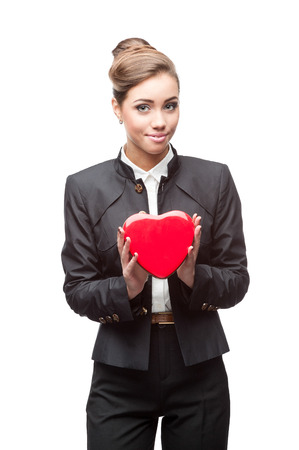 caucasian young happy business woman holding red heart. isolated on white photo