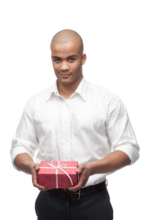 young smirking black man holding red gift isolated on white photo