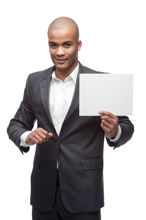 young cheerful black businessman holding sign isolated on white photo