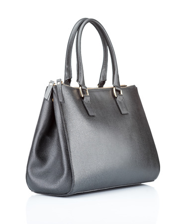 handbag: black leather female handbag. isolated on white