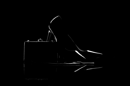 high heel shoes: silhouette composition of female high heel shoes and clutch isolated on black