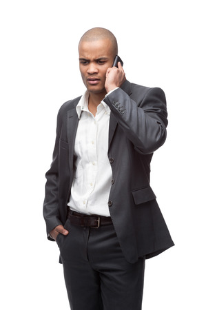 young worried black businessman talking on cell phone isolated on white photo
