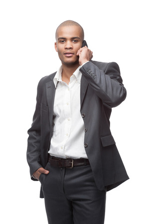 black young businessman in gray suite talking at cell phone isolated on white photo