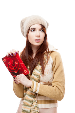 young sensual casual caucasian brunette woman holding red postcard. isolated on white photo