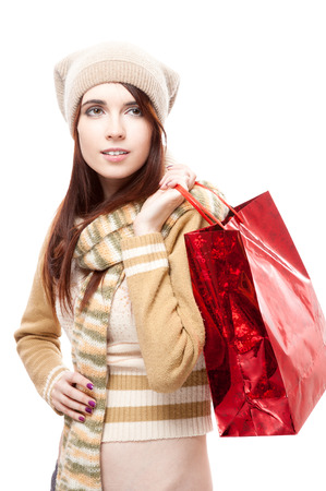 young smiling casual caucasian brunette woman holding shopping bag. isolated on white photo