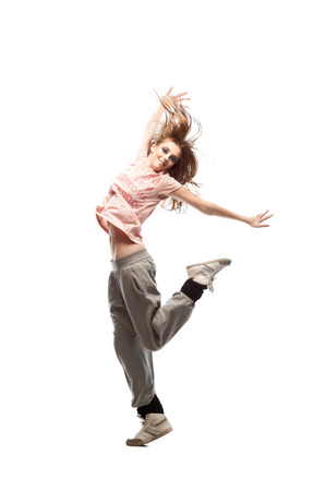 beautiful young casual caucasian  hip-hop dancing woman  over gray background