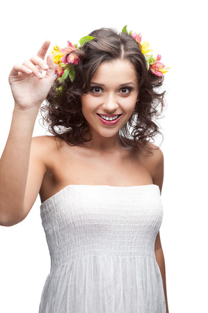 portrait of young attractive caucasian woman with lily flowers in hair isolated on white photo