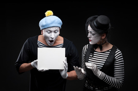 couple funny mimes holding sign photo