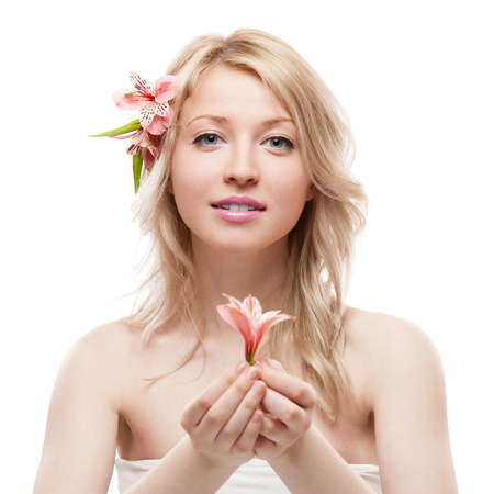 beautiful blond caucasian young woman with flower in hair isolated on white photo