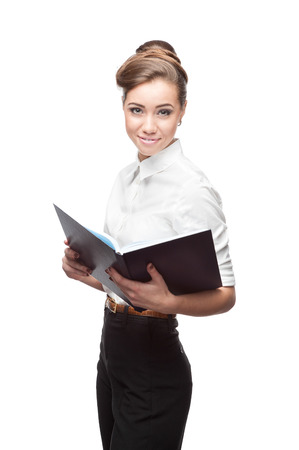 young smiling business woman holding blue diary isolated on white photo