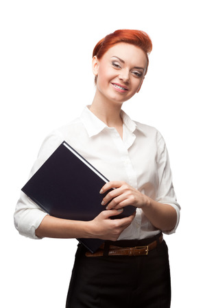 young red-haired caucasian smiling business woman holding diary isolated on white photo