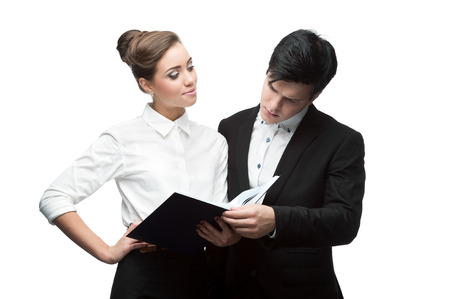 young caucasian businessman and woman holding diary book and having discussion photo