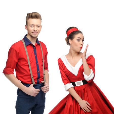 cheerful young surprised caucasian couple in red vintage clothing isolated on white photo