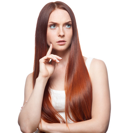 portrait of young thoughtful casual caucasian red haired girl isolated on white photo