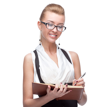 young cheerful caucasian businesswoman holding diary and pen isolated on white photo
