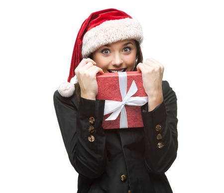 young cheerful caucasian brunette businesswoman in black suit and santa hat holding christmas gift isolated on white photo
