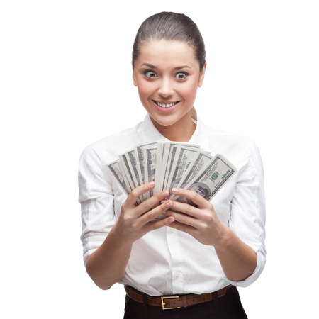 young cheerful caucasian brunette businesswoman in white blouse holding money isolated on white photo