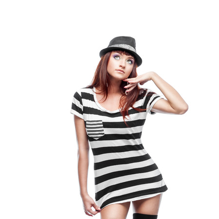 causasian: young thoughtful stylish casual causasian brunette woman in hat and black and white short dress. isolated on white Stock Photo