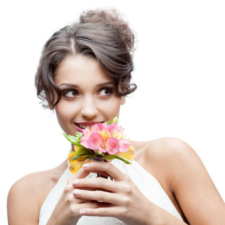 young attractive thoughtful caucasian woman with lily flowers in hand photo