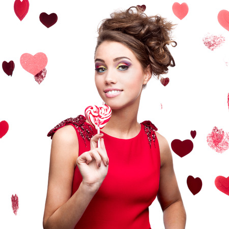 caucasian happy stylish young woman holding lollipop. isolated on white Stock Photo