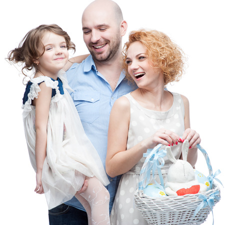 caucasian happy casual family with easter basket isolated on white photo