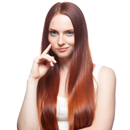 smirking: attractive young  casual caucasian red haired smirking girl isolated on white