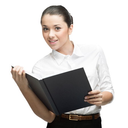 cheerful caucasian smiling young businesswoman holding book isolated on white photo