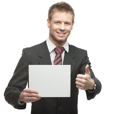 young smiling caucasian businessman in black suit holding sign isolated on white photo