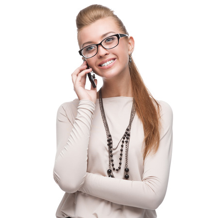 young cheerful caucasian businesswoman talking on cell phone isolated on white photo