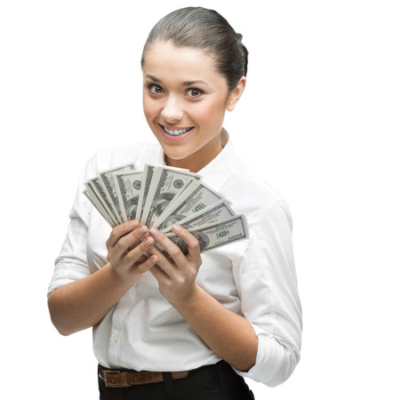 young thoughtful caucasian businesswoman in white blouse holding money isolated on white background photo