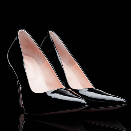 high heel shoes: black  varnished leather female high heel shoes Stock Photo