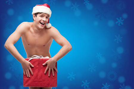 funny topless man holding red gift