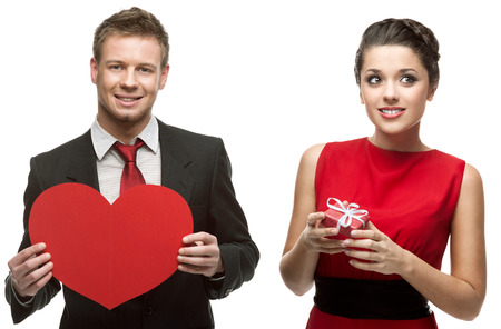 young handsome man holding red heart and smiling woman holding gift isolated on white background photo