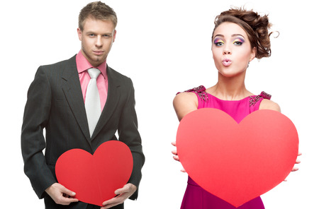 young handsome man holding red heart and cheerful woman  isolated on white background photo
