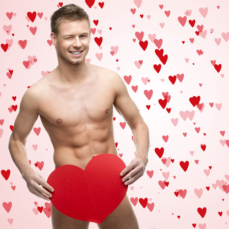 naked man: funny naked man holding red heart Stock Photo