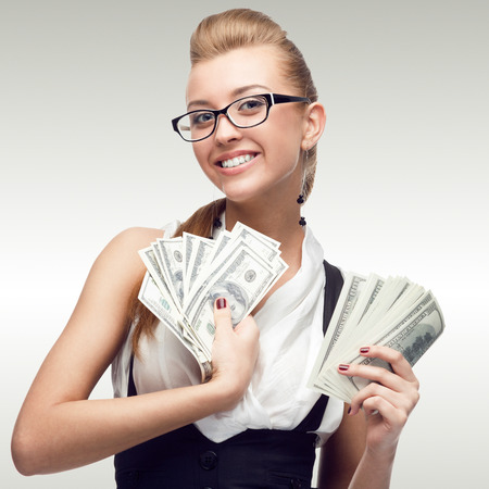 smiling young business woman standing over gray background photo