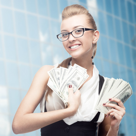 smiling young business woman standing over blue background background photo