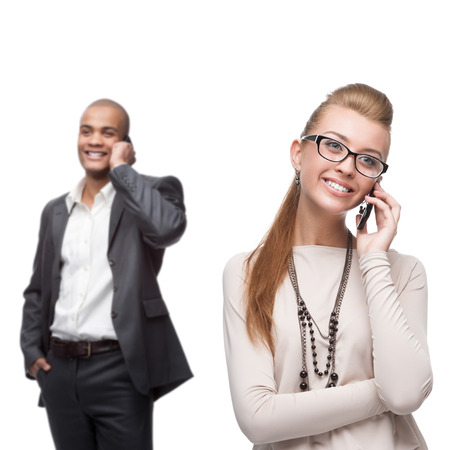 happy smiling business people calling by mobile telephone isolated on white photo