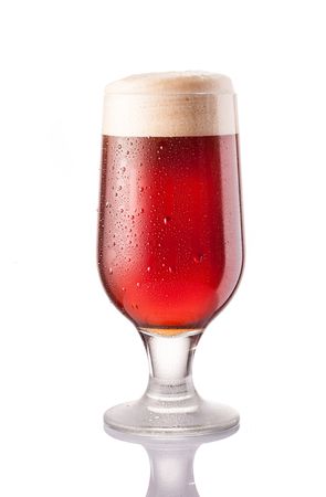 dark cold beer in frosty glass isolated on a white background