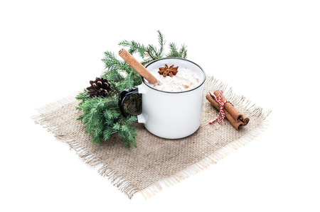 eggnog cocktail in mug arranged with christmas decoration isolated on white background