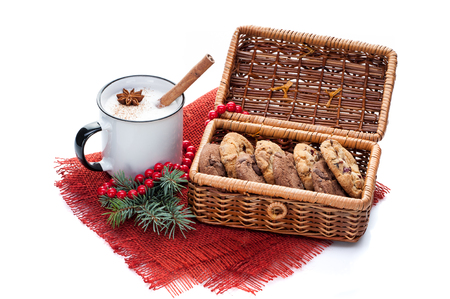 eggnog cocktail in mug arranged with christmas decoration and cookies basket isolated on white