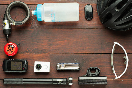 Items replacements and tools for a cycling: bike lock, flask, pulse sensor, helmet, bell, navigator, action camera, multitool, pump, led spotlight, glasses.