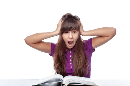 Portrait of female student  holding his head and feel nervous to face exam.