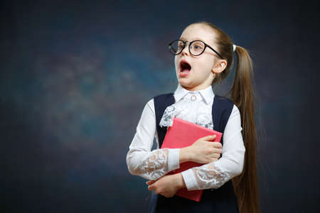 Caucasian Schoolgirl with Open Mouth Hold Book