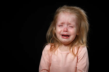 Portrait of Crying, Yelling, Abused Helpless Baby Girl After Family Conflict. Got Lost. In Difficulty. Family Conflict, Violence, Injustice, Unfairness. Foto de archivo