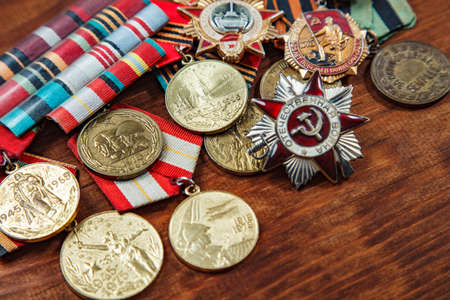 Order of the Patriotic War in St. and Medals for the victory over Germany on a table. close up. selective focus image