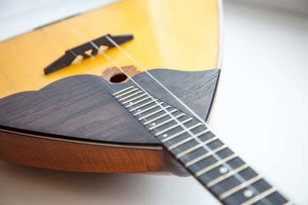 ethnics: balalaika Russian folk musical instrument yellow