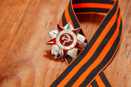 prowess: Symbols of Victory in Great Patriotic War on wooden background